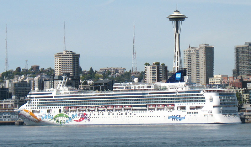 Norwegian Pearl Cruise Ship, in front of the Seattle Space Needle, as seen from the Bremerton to Seattle Ferry